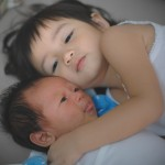 A tender moment between sister and brother. Captured by Darren Lim.