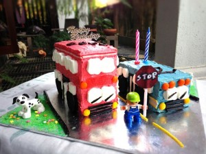Birthday buses with Duplo boy and dog (STOP sign made with paper, crayon and Yakult straw)