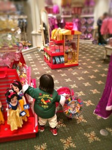 Totally absorbed in the magical experience of shopping in a Disney store