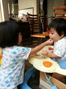 One of the uses of a little sister: to eat your unwanted food