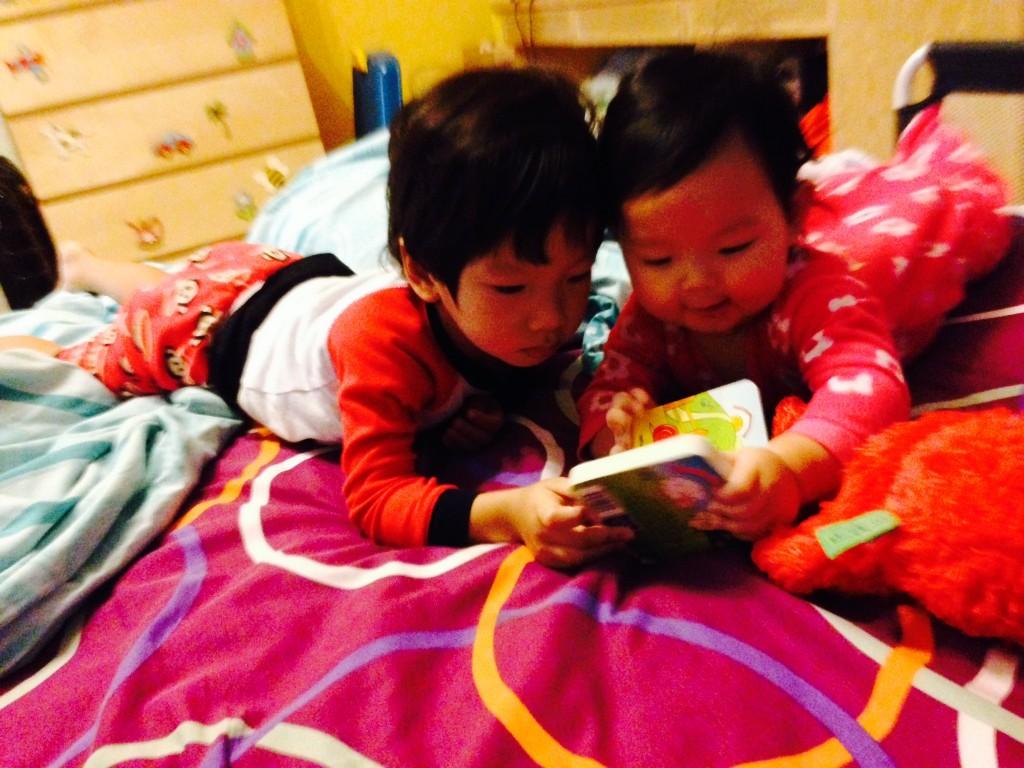"Cristan ""reading"" to Caris. So cute!!!"