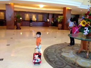 Cristan excitedly showing us the way to check-in, toting his Mickey Mouse luggage bag