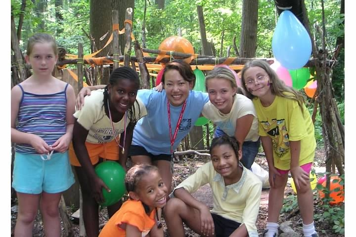 "At summer camp with my group of 10-year old girls, at our ""fort"" in the woods."