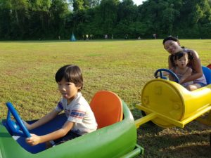 Super-fun on a barrel ride, pulled by a tractor on a big open field at the Bukit Timah Saddle Club