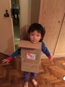 Boredom makes cardboard boxes very interesting. He says he's a robot!