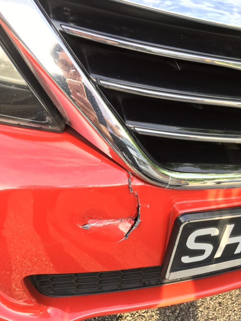 Cracked front bumper of the cab that collided into me