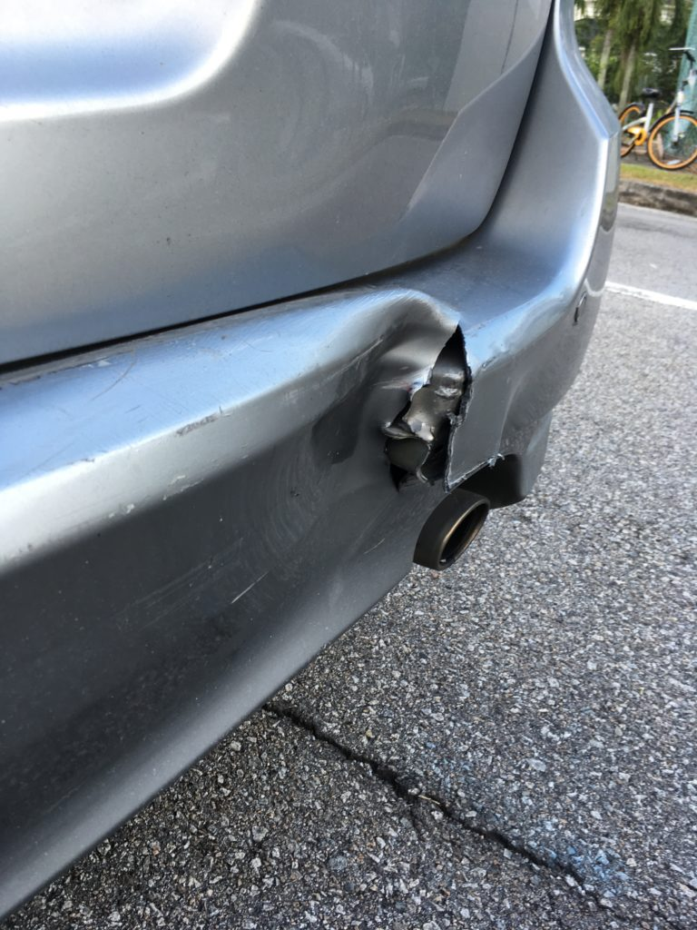 It was just a minor bump, but the impact managed to tear both vehicles' bumpers!
