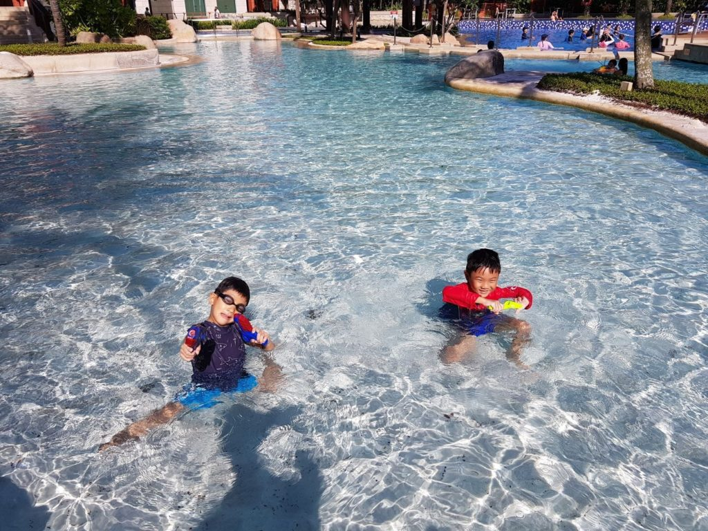 Enjoying the amazing pool - just like a real beach but without the saltwater that stings the eyes!