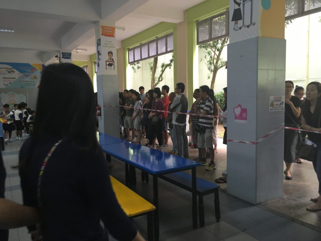 The parents had to stand at the perimeter of the canteen to observe their children from afar