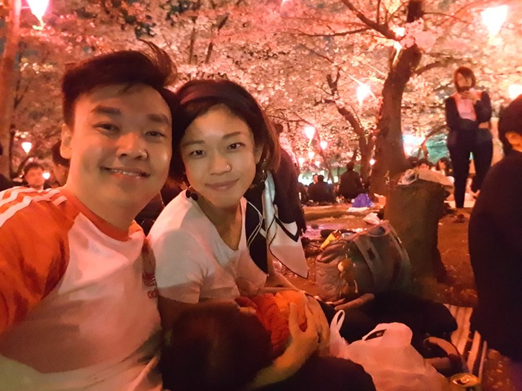Our first memorable Hanami experience. Traveling with this monkey didn't stop us from enjoying good 'ol couple time under hundreds to blossoming Sakura trees
