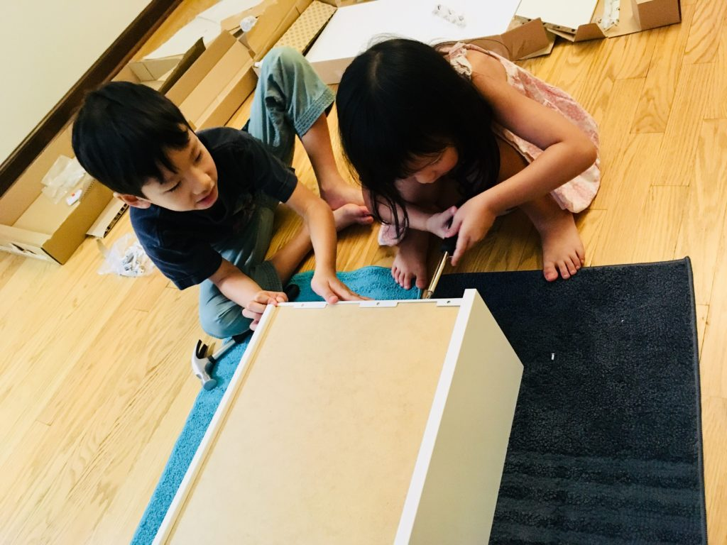 The munchkins were so excited to help out in furniture assembly!